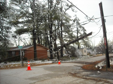 Downed power lines hang precariously over a Monette intersection