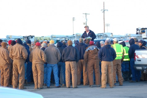 Entergy workers receive instructions before heading out to restore power to local residents on Feb. 2.