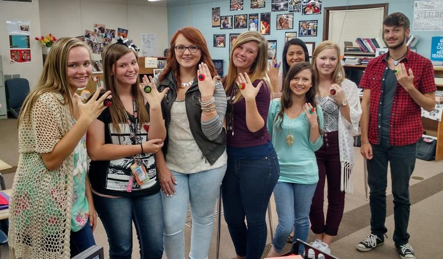2015-2016 staff members during the annual commitment ceremony. Each year the entire staff pledges to produce quality work on both the online newspaper and yearbook. Staff members are, from left, Cadyn Qualls, Shyla Clayton, Lexie Ray, Kensie Walker, Stephanie Atchley, Joanna Perez, MJ Ivy and Camden Metheny
