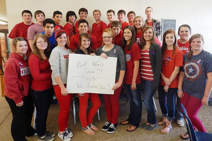 Sophomores+show+their+support+for+classmate+Kayla+Griffin+by+wearing+red+on+the+day+of+her+open+heart+surgery.