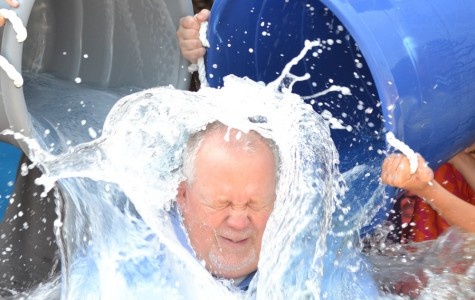Principal Randy Rose accepts the ALS ice bucket challenge from the cheerleaders.