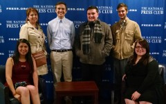 Joanna Perez, Tracey Yates, Drew McFall, Greydon Williams, Camden Metheny and Olevia Hughes at the National Press Club. After dining at the club's Fourth Estate Restaurant, they were allowed to explore the area, including the press conference room.