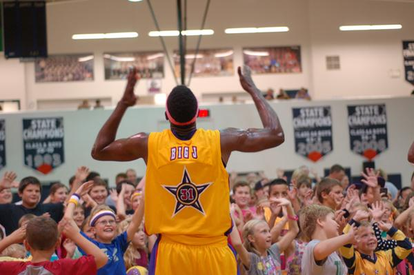 Wizard Big J gets the crowd going at the end of the game.