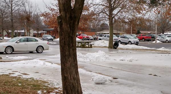 The faculty parking lot and sidewalks were still ice covered when students returned to school this week.