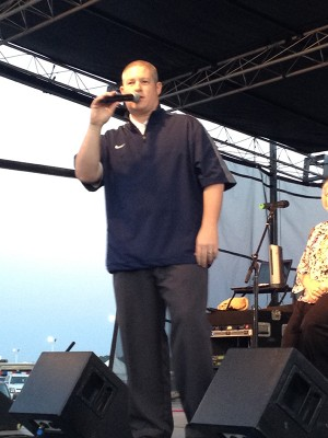 Coach Justin Yates on stage at the NEA District Fair.