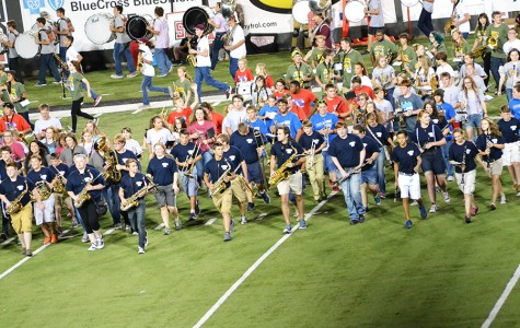 Band members take the field during the halftime of Saturday's ASU Red Wolves game.