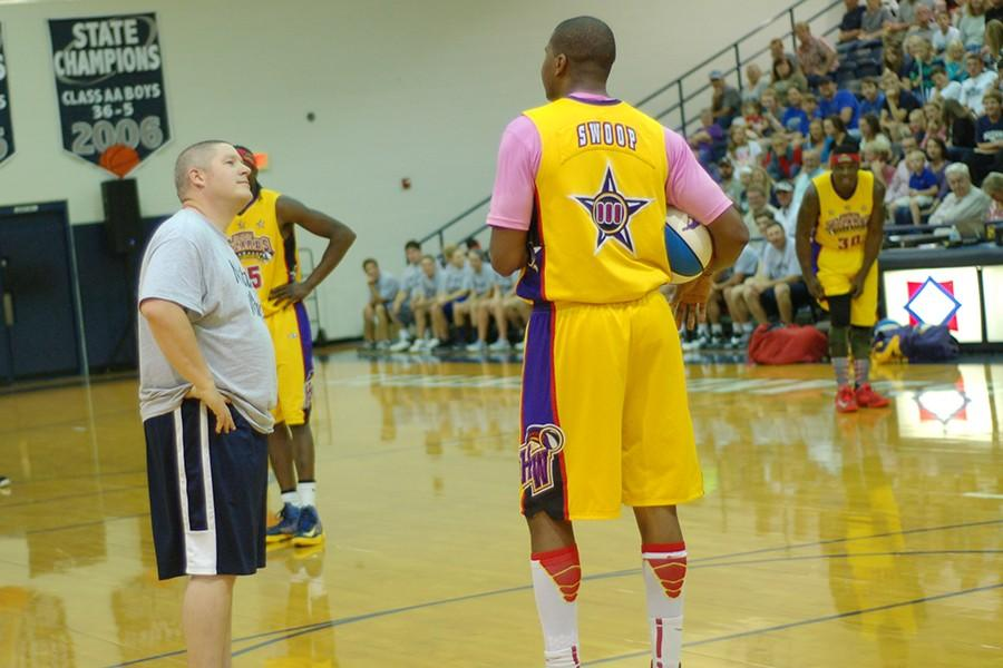 Coach Justin Yates during last year's Harlem Wizards game. Yates will perform as the master of ceremonies for the NEA District Fair concerts Thursday night.