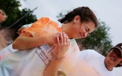 Samantha Gipson braces for a burst of orange at the final color station.