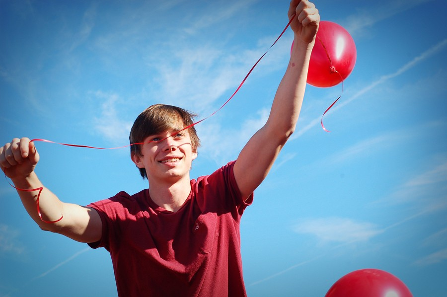 Senior Jacob Cater is lifted up during the balloon release at Thursday's Red Ribbon assembly. The program was conducted by the EAST students and featured a video and two area residents who spoke about overcoming addiction. Following the presentation, students and staff gathered in front of the MAC for a balloon release.