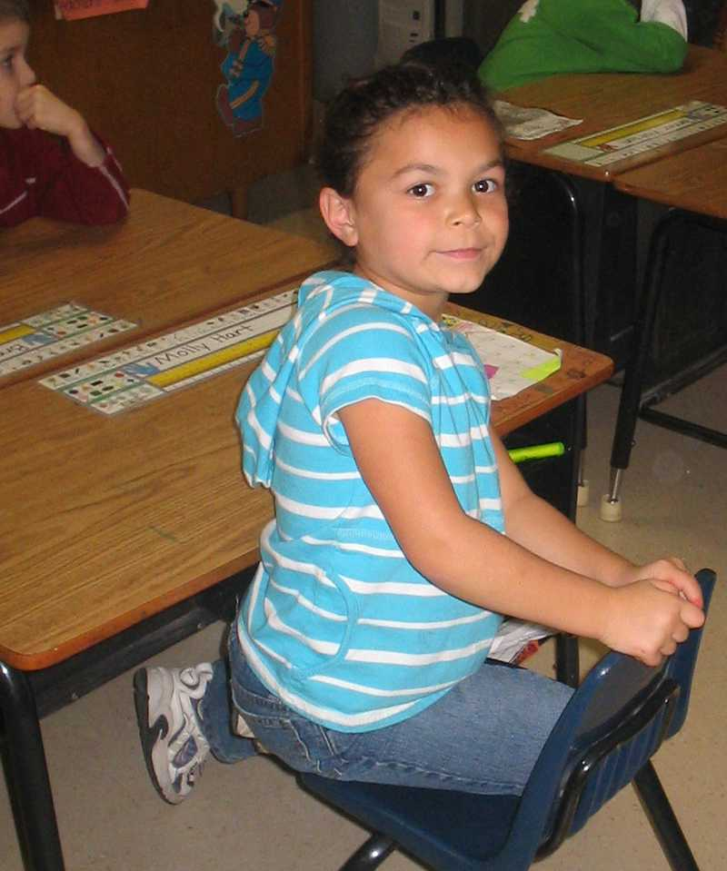 Sophomore Molly Hart sits at her elementary school desk in this 2006 photo.