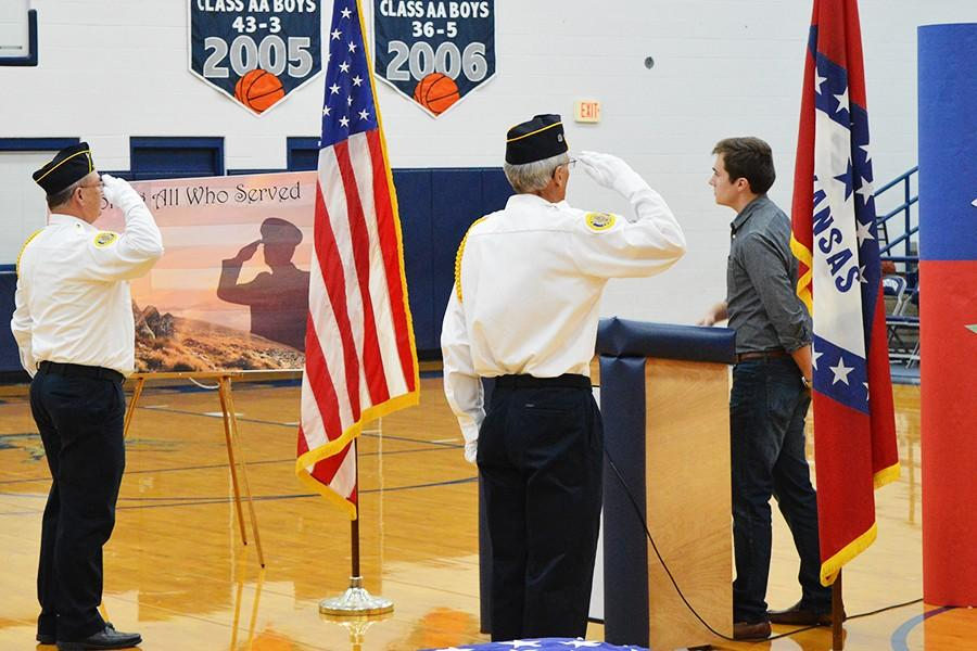 Color+guard+members+Dickie+Pace+and+Robert+Chambers+salute+as+Drew+McFall%2C+11%2C+leads+the+Pledge+of+Allegiance.