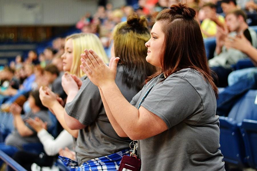 Sarah Vaughn, 12, applauds the speakers during the assembly.
