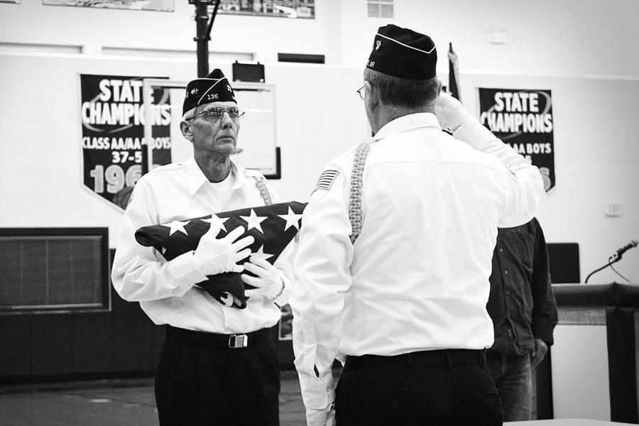 Robert Chambers of Monette participates in the flag folding ceremony at last week's Veterans Day program.