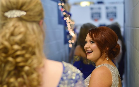 Junior princesses Lexie Ray (right) and Avery Uthoff joke around while waiting for the homecoming ceremony to start.