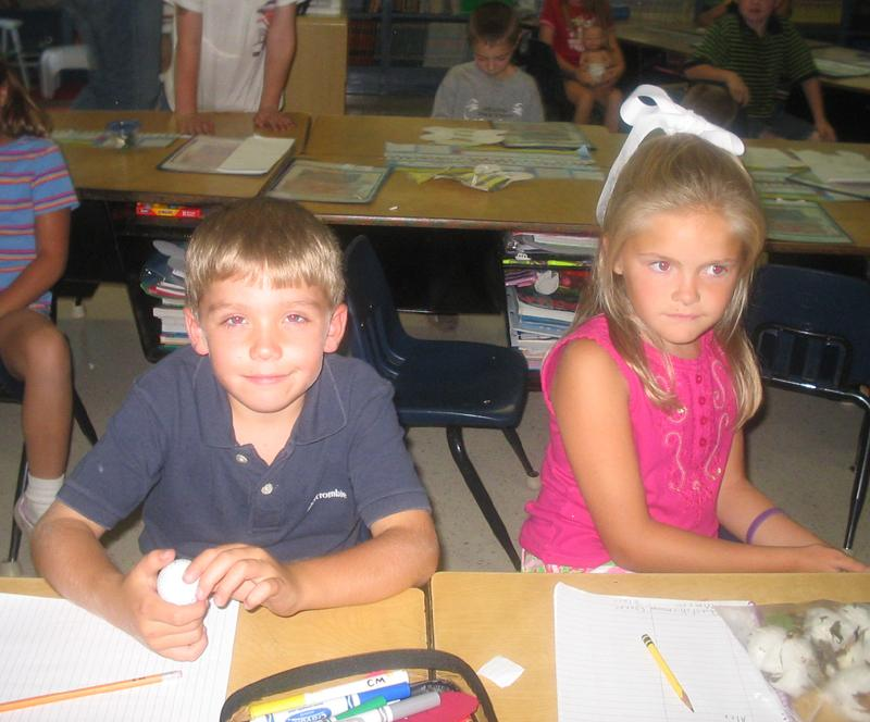 Seniors+Connor+Miller+and+Blaire+Wildy+work+at+their+desks+in+this+photo+from+2005.+