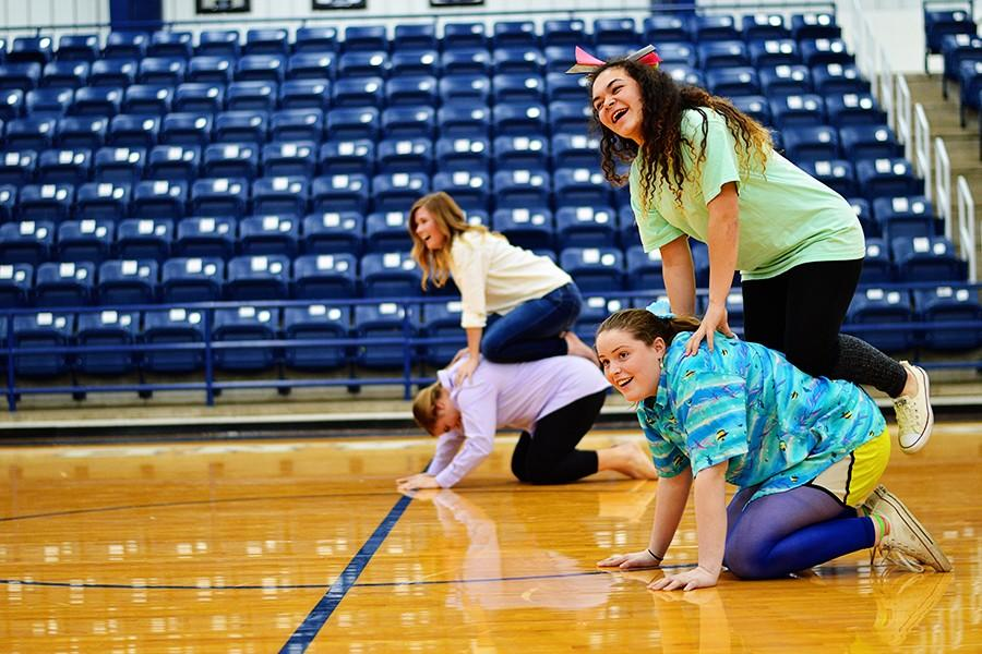Sophomores Holly Stockton and Molly Hart (front) and juniors Jonna Carmichael and Kensie Walker during the Chicken on a Henhouse event at the Wacky Olympics.