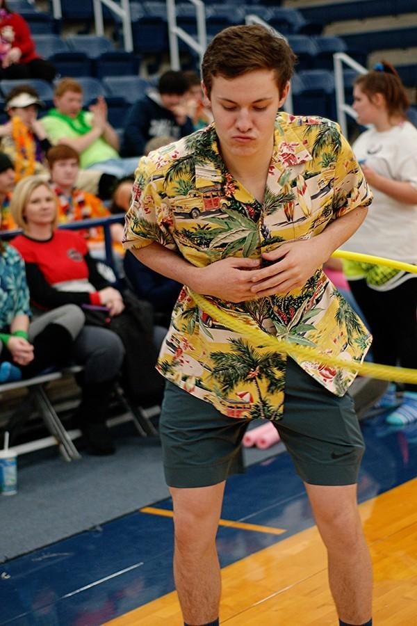 Junior Dax Hurst practices his hula hoop skills for Wacky Olympics.