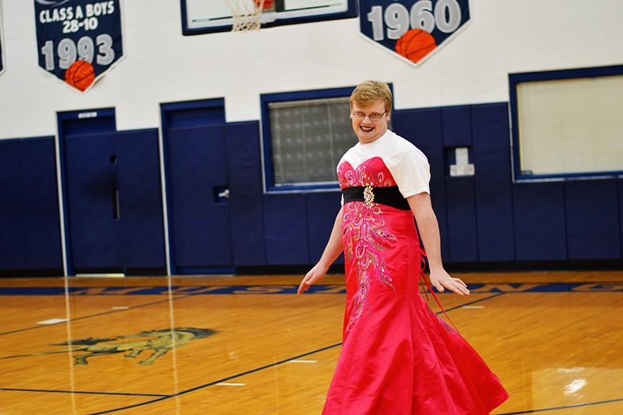 Senior Trevor Couch does his best pageant strut.