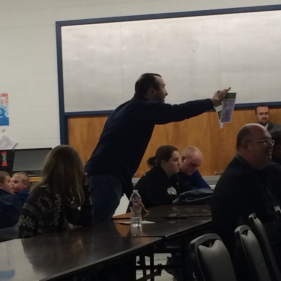 Brandon Decker reacts to John Steele's comments on the millage increase amount at Tuesday's meeting in Monette.