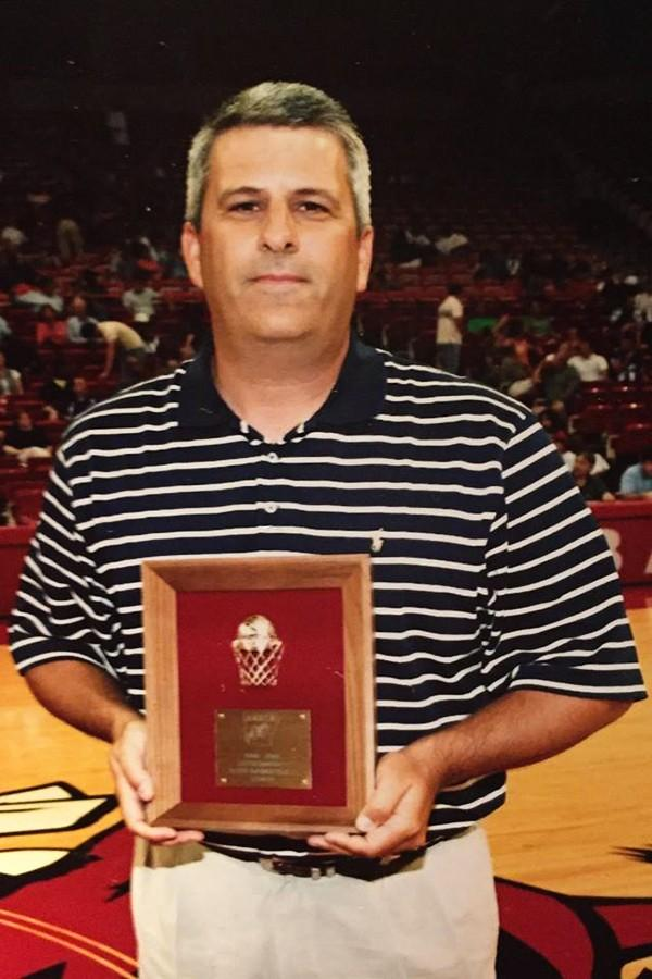 Taylor receiving the Arkansas High School Coaches Association Basketball Coach of the Year award in 2006.