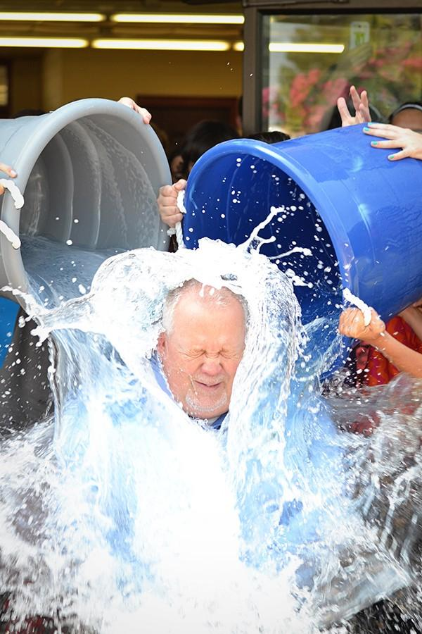 Principal Randy Rose gets drenched by the high school cheerleaders for the ALS ice bucket challenge. Even though he doesn't participate in social media, Rose accepted the challenge and issued his own challenge to elementary principals Dr. Kima Stewart and Nicole Stewart.
