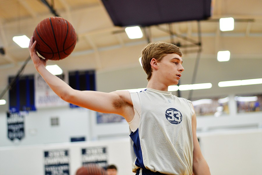 Junior Cory Turner and the rest of the Mustangs shoot around during eighth hour Friday. The team's season ended Thursday night at the district tournament in Marked Tree.