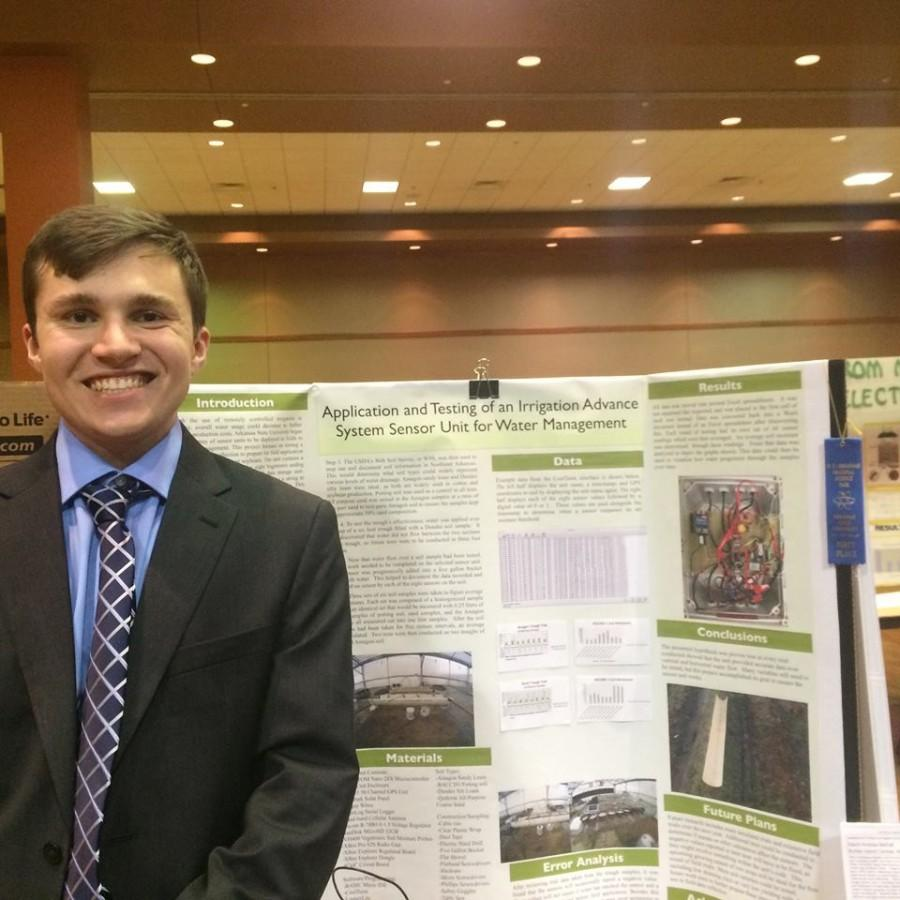 Junior Drew McFall with his Science Fair project.