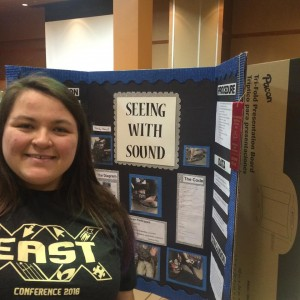 Senior Olevia Hughes with her Science Fair project.