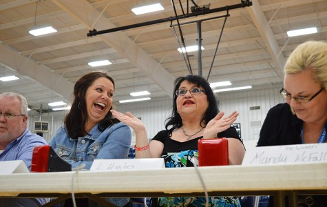 Principal Randy Rose, Stephanie Woods, Lisa Hughes and Mandy McFall react during the student-teacher Quiz Bowl game on Wednesday. The teachers played the Quiz Bowl team in preparation for the state tournament on April 9. The teacher team won with a score of 240-210.