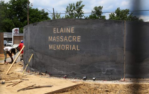 In this June 15, 2019, photo, men work near a monument under construction honoring victims of the Elaine Massacre that sits across from the Phillips County courthouse in Helena, Ark. The Elaine Massacre Memorial is set to be unveiled in September and is being chaired by some descendants of the massacre